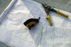 Tools and Blueprints. On a concrete slab in early morning side light Stock Photography
