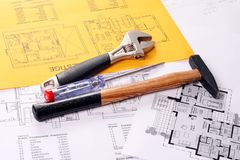 Tools on Blueprints house project Stock Photos