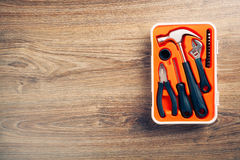 Tools box on wooden background royalty free stock images