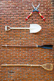 Tools on the brick wall Stock Images