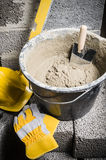 Tools for bricklayer bucket with a solution and a trowel Stock Photos
