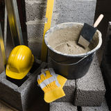 Tools for bricklayer bucket with a solution and a trowel Stock Image