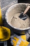 Tools for bricklayer bucket with a solution and a trowel, close royalty free stock images