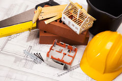 Tools, building and construction equipment. Building and construction equipment on blueprints Royalty Free Stock Image