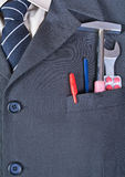 Tools  in the businessman pocket Royalty Free Stock Images