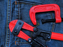 Tools. C-clamp and Steel scissors on Jeans background Royalty Free Stock Photography
