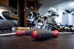 Tools and carburetor. On a workbench Royalty Free Stock Image