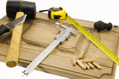 TOOLS carpenter. Instrum different carpenter on a piece of wood Stock Photos