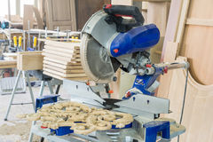 Tools in the carpentry workshop. Tools in the carpentry workshop: electric circular saw Royalty Free Stock Photos