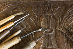 Tools for carving on a carved plank Stock Photos
