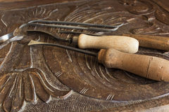 Tools for carving on a carved plank Stock Photography