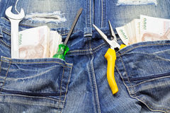 Tools and cash Stock Photos