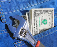 Tools and cash in pocket Royalty Free Stock Images