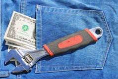 Tools and cash in pocket Stock Photo