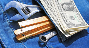 Tools and cash in pocket Stock Photos
