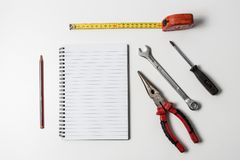 Tools check list notepad royalty free stock photos