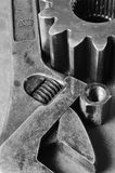 Tools and cogs in black/white. Giant wrench, spanner, nut and cog against rust in black/white Stock Photos
