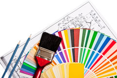 Tools and color guide. Paint brush, pencils, drawings and color guide on white stock photos