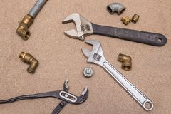 Hydraulic tools - adjustable keys. Brass and steel tools and fittings. Royalty Free Stock Photo