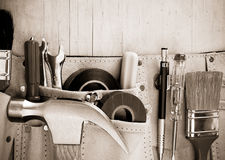 Tools in construction belt on wooden background Royalty Free Stock Photo
