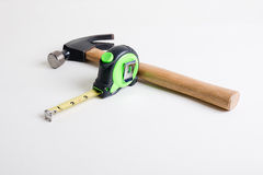 Tools. Construction tools - a hammer, tape measure royalty free stock image