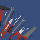 Tools for construction and repair are located in the corner of the composition Royalty Free Stock Photos