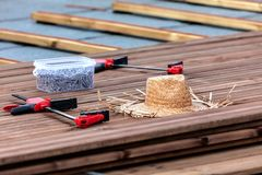 Tools for the construction of a wooden floor or terrace. Screwdr royalty free stock images