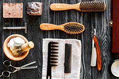 Tools for cutting beard barbershop top view on wooden background. Tools for cutting beard barbershop top view on dark wooden background royalty free stock image