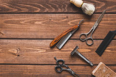 Tools for cutting beard barbershop top view. On wooden background stock photos