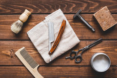 Tools for cutting beard barbershop top view. On wooden background Royalty Free Stock Image