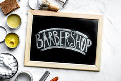 Tools for cutting beard in barbershop on workplace background top view royalty free stock image