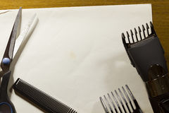 Tools for cutting hair. On a white sheet of paper stock photos