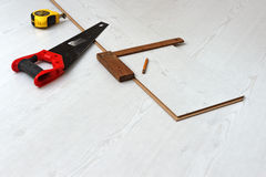 Tools for cutting laminate floor board Royalty Free Stock Photos