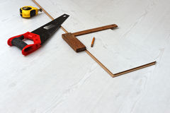 Tools for cutting laminate floor board Stock Photography