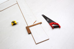 Tools for cutting laminate floor board, concept of home improvements process Stock Image