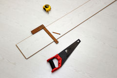 Tools for cutting laminate floor board, concept of home improvements process Stock Photo