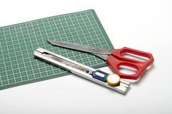 Tools on cutting mat Stock Photos