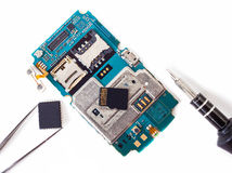 Tools and disassembled phone memory card Royalty Free Stock Photo