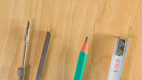 Tools for drawing and measuring. On a wooden background Royalty Free Stock Photos