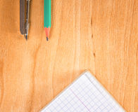 Tools for drawing and measuring. On a wooden background Stock Photos