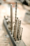Tools drill bit on wooden work table. Close up of tools drill bit on wooden work table Royalty Free Stock Photo