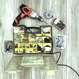 Tools, Drill and Organizer with pieces.top View. Photo Image Stock Photos