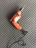 Tools electric drill for handing. Drill orang workshop stock photos