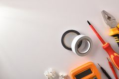 Tools and electrical material on white table space left stock photography