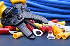 Tools for electrician and cables. On metal surface Stock Photos