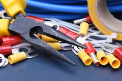 Tools for electrician and cables. On metal surface Royalty Free Stock Image