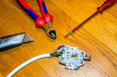 Tools for electricity. Screwdriver, knife, wire Royalty Free Stock Photography