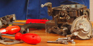 Tools and engine parts in the workplace automotive serviceman Royalty Free Stock Photography