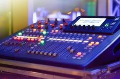 Tools of entertainment. DJ , MC digital sound  mixer at a concert during night royalty free stock photo