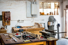 Tools and equipment used for carpentry. In a dusty workshop Stock Photography